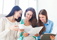 Female students studying together at home Royalty Free Stock Photos