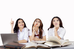 Female students thinking idea together Royalty Free Stock Images