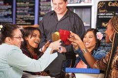 Female Students Toasting Stock Photo
