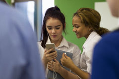 Female Students Watching Videos on Smartphone stock photos