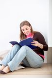 Female studying at home Stock Images