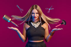 Female stylist with hair flying holding makeup brushes Stock Images