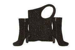 Female suede boots and bag. Pair of stylish female suede boots and a suede bag with costume jewellery isolated stock photos