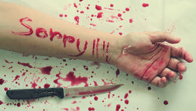 Female suicide with the Sorry messages. Female suicide, Sorry messages , Knife on the hand,Vintage style royalty free stock photography