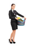 Female in a suit holding a laundry basket Royalty Free Stock Photography