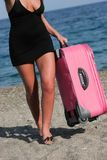 Female with suitcase Stock Images