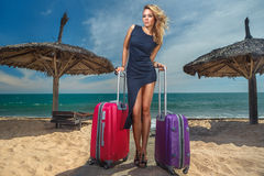 Female with a suitcases Stock Images