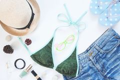 Female summer collection with bikini, short jeans, accessories and cosmetics Stock Photography