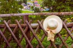 Female summer hat hanging on the wooden rustic fence Royalty Free Stock Photos