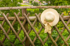 Female summer hat hanging on the wooden rustic fence Royalty Free Stock Photography