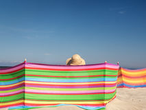 Female sunbather at the beach Royalty Free Stock Image