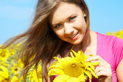 Female with sunflower Royalty Free Stock Photos