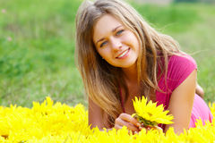Female with sunflower Stock Images