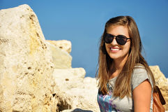 Female with sunglasses. Pretty young female with sunglasses on at the beach Stock Images