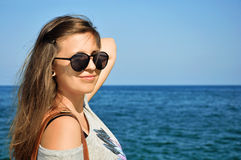 Female with sunglasses. Pretty female with sunglasses on at the beach Royalty Free Stock Images
