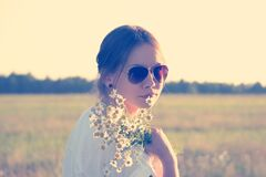 Female in Sunglasses Holding White Flowers Royalty Free Stock Images
