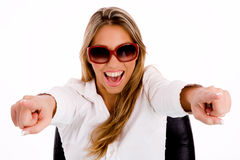 Female with sunglasses pointing with both hand Stock Photo