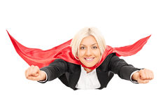 Female superhero flying isolated on white background Royalty Free Stock Photos