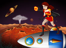 A female superhero at the galaxy standing above the spaceship Stock Images