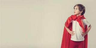 Female superhero kid posing in studio