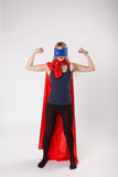 Female superhero shoes her muscle power. Stock Images