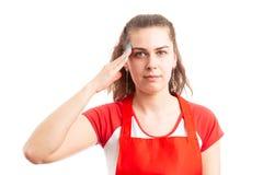 Female supermarket or hypermarket employee military saluting royalty free stock images