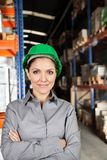 Female Supervisor With Arms Crossed At Warehouse Stock Images
