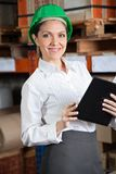 Female Supervisor With Book At Warehouse Royalty Free Stock Photography