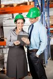 Female Supervisor And Colleague Using Digital Royalty Free Stock Photos