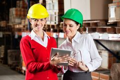 Female Supervisor With Colleague At Warehouse Stock Images