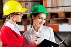 Female Supervisor And Colleague Working Together Stock Photos