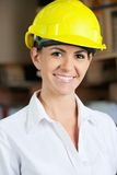 Female Supervisor Wearing Hardhat At Warehouse Stock Image