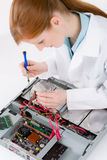Female support computer engineer - woman repair. Female support computer engineer - IT woman repair defect Royalty Free Stock Photography