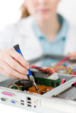 Female support computer engineer - woman repair. Female support computer engineer - IT woman repair defect Stock Images