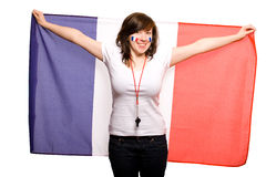 Female supporter of french team, isolated. Young happy female supporter of french team, isolated on white background, she also has her cheeks painted with french Stock Photo