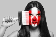 Female in national colors of Canada Royalty Free Stock Photography