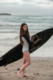 Female surf girl looking at small waves. Stock Photo