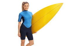 Female surfer holding a surfboard Stock Photography