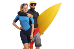 Female surfer with a male surfer holding a surfboard. Isolated on white background Stock Image