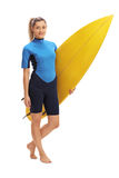 Female surfer posing with surfboard. Full length portrait of a female surfer posing with a surfboard isolated on white background Stock Photo