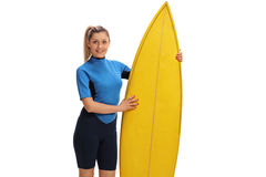Female surfer posing with a surfboard. Isolated on white background Royalty Free Stock Photography