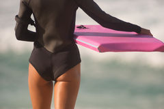 Female Surfer Stands Beach Watching Surf Waiting Pink Body Board Royalty Free Stock Image