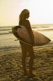 Female Surfer With Surfboard On Beach Stock Images