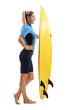 Female surfer with a surfboard Royalty Free Stock Images