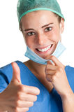 Female Surgeon. Smiling and giving a thumbs up Royalty Free Stock Photography