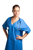 Female Surgeon. Young female surgeon with scrubs, holding a face mask on a white background Stock Photos