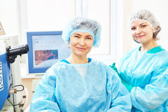 Female surgeon with assistant in operation room Stock Photo