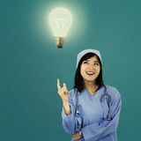 Female surgeon and bright lamp Royalty Free Stock Photography
