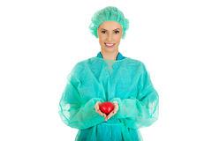 Female surgeon doctor with heart. Smiling female surgeon doctor with heart royalty free stock image