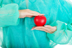 Female surgeon doctor with heart. Smiling female surgeon doctor with heart royalty free stock images